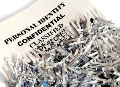 pile of shredded confidential papers