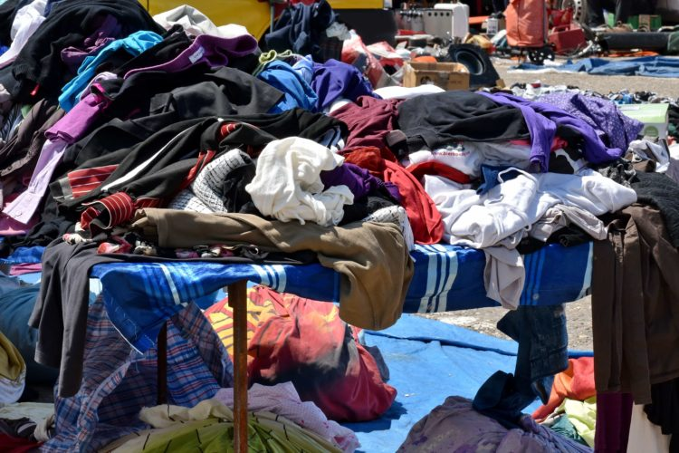 piles of clothing being sorted for textile recycling